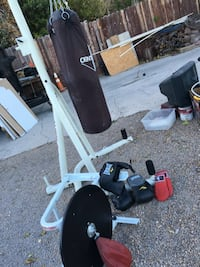 black heavy bag with white metal stand