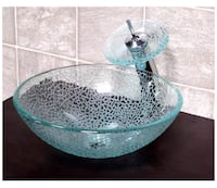Glass vessel sink never been used still in box comes with waterfall faucet and all needed hardware $200 each or both for $380 Lubbock, 79424