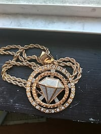gold-colored diamond encrusted pendant necklace