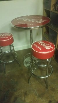 red and silver steel bar stools and pub table  Washington, 20009