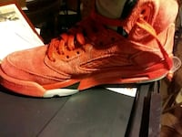 paired red Air Jordan 5 shoe Milwaukee, 53212