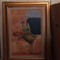 Brown wooden framed painting of woman wearing brown sunhat Broadlands, 20148