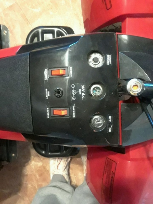 MOTOR BIKE WITH CHARGER 59747cc9-328a-4fce-9209-bf542e5c3ec6