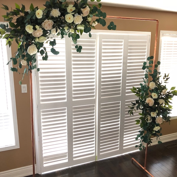 Rental arch with artificial flowers and greenery  3fdb5d3c-4dd3-40db-bf02-a323758939f9