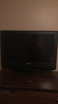 black flat screen TV with remote Terrace Park, 45174
