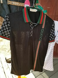 black, red, and green Gucci polo shirt