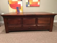 Beautiful wood coffee table.  Lots of storage!  Herndon, 20171