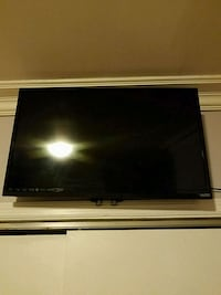 black flat screen TV with remote Brooklyn, 11221