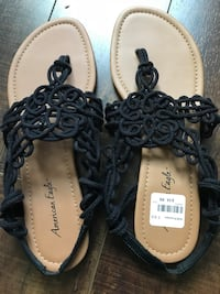 Brand new with box Pair of black-and-brown leather sandals New Westminster, V3L 3C6