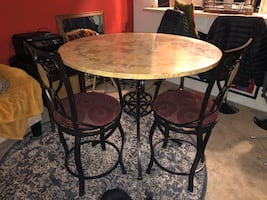 Tall round dining table with chairs