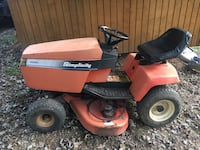 Red and black riding mower Millville, 25432
