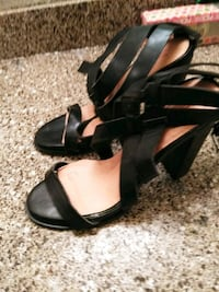 pair of black leather open toe ankle strap heels Houston, 77060