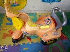 baby's orange and yellow ride on toy