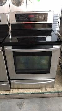 DELIVERY & WARRANTY - LG Stainless steel stove glass top  Toronto, M6H