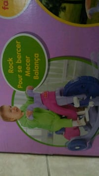 baby's green and blue bouncer seat box