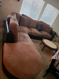 Faux Leather/Suede Sectional Couch with four pillows