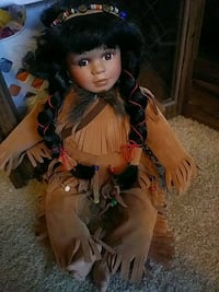 brown haired female doll in brown dress