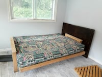 Queen size futon, solid wood frame.