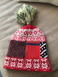 Red, white, and black bubble hat...Authentic, Burberry, new with tag.Unisex. Centreville, 20120