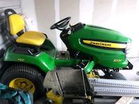 green and yellow John Deere ride on lawn mower DeLand, 32724