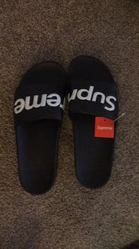 pair of black-and-white Adidas slide sandals Conway, 29526