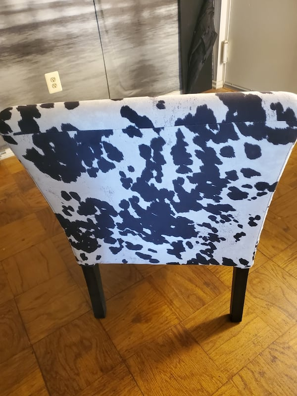 Two cow print chairs dfba6763-f7d6-406b-8042-463e98f9156c