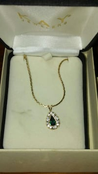 gold-colored with green gemstone pendant necklace case