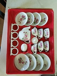 white-and-pink floral-print ceramic tea cup set