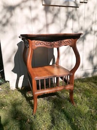 Carved wood end table