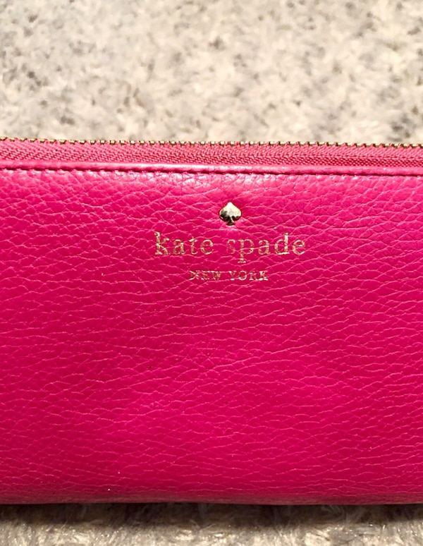 """Kate Spade wallet paid $178 good condition. The wraparound zip opens to a lined interior with a dividing zip pocket, checkbook compartment, 2 bill slots, and 12 card slots. Exterior back pocket. Measurements 7 ¾""""W x 4""""H x 1""""D. Has minor imperfections in o ce5c6ae5-02ad-4773-91b5-ad0a0955668b"""