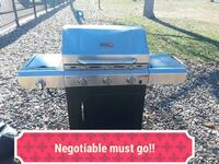 stainless steel and black gas grill