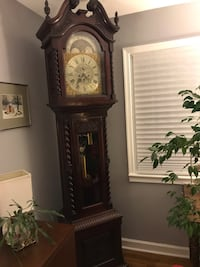 Brown wooden grandfather's clock