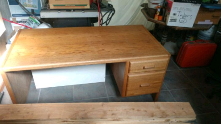 Photo I have for sale a very nice solid oak desk heavy duty excellent condit