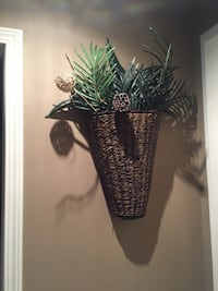 brown and black wicker wall planter