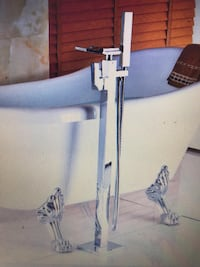 Floor standing waterfall tub faucet