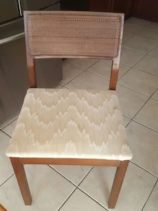 brown wooden padded chair