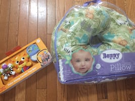 Boppy pillow and brand new baby toy