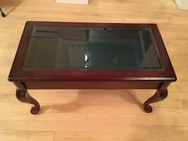 Coffee table with glass top and slide out shelf
