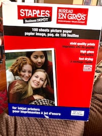 """Staples photo paper, 8 1/2""""x 11"""", glossy. 100 sheets . Never opened"""