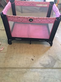 Baby's black and pink graco pack n play Lorton, 22079