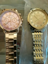 two round gold chronograph watches with link bracelets