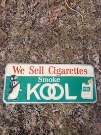 green, white, and red We Sell Cigarette Smoke Kool steel signage Strasburg, 44680