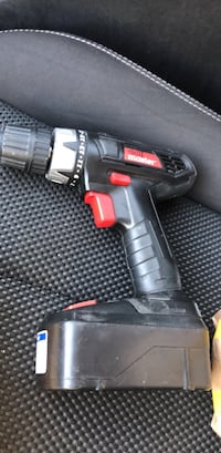 black and red cordless hand drill 34 mi