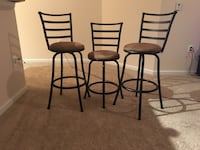 two black metal framed brown padded bar stools Herndon, 20171