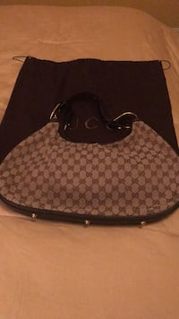 brown and black monogrammed Gucci leather hobo bag