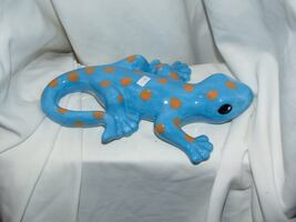 Blue ceramic lizard .