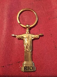 gold-colored Christ the Redeemer key chain