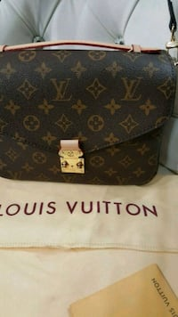 brown Louis Vuitton leather wallet Mississauga, L5T 2L8