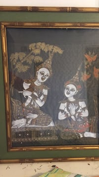 black wooden framed painting of woman in dress