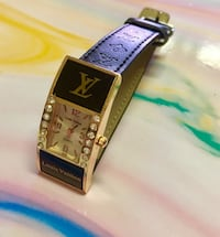 Black and gold LV watch